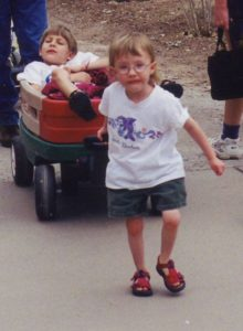 Rachel pulls her brother uphill in a wagon